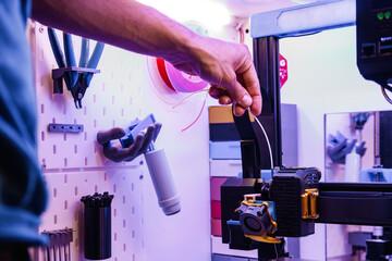 Obraz Assembly of 3D printer filament in the machine - fototapety do salonu