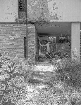 abandoned modern design house facade and garden