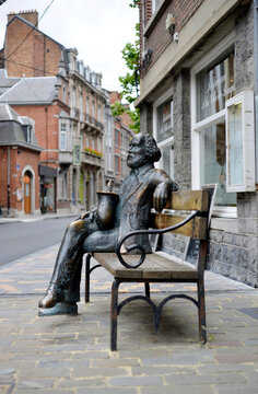 Dinant, Belgium, sculpture of the saxophone inventor Adolphe Sax on a bench in front of the Museum