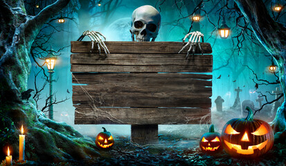 Fototapeta Halloween Party Card - Pumpkins And Skeleton In Graveyard At Night With Wooden Board  obraz