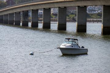 Fototapeta premium boat tied to buoy on the river close to bridge