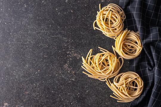 Italian pasta nest. Uncooked spaghetti nest.