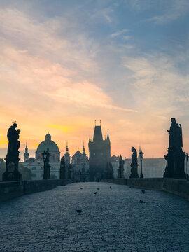 Charles Bridge bridge at fogg in dawn on sunrise. Prague, Czech Republic. popular tourist attraction. Travel and sights of city breaks. landmarks, travel guide and postcard.