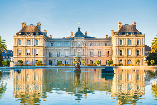 Luxembourg garden with pond, fountaine and building of Luxembourg Palace with no people. Paris, France
