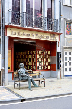 Dinant, Belgium, Adolphe Sax Museum with sculpture of him on a bench in the street