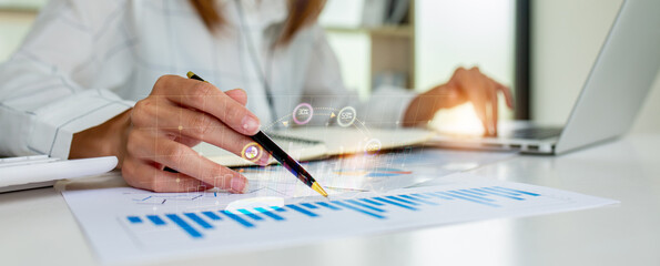 Fototapeta Close up of Business woman accountant or financial expert coins double exposure analyze business report graph finance chart corporate finance economy banking business stock market research concept.   obraz