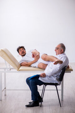 Old male doctor psychiatrist examining young male patient