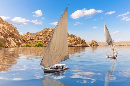 Sailboats near Agilkia island, Philae, Aswan, Upper Egypt