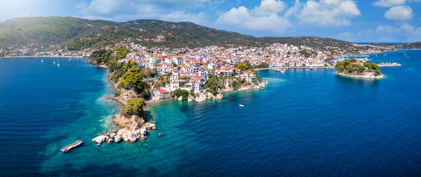 Panoramic view to the harbor and town of Skiathos island, Sporades, Greece, with Bourtzi peninsula and Plakes area in front