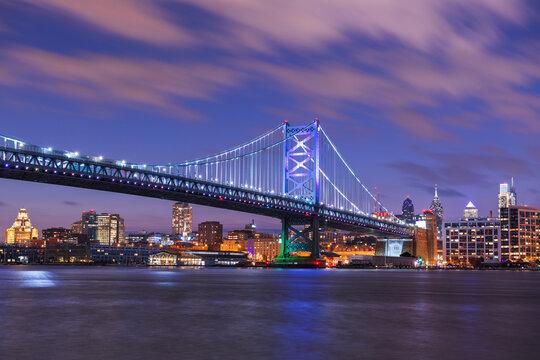 Philadelphia, Pennsylvania, USA skyline on the Delaware river with Ben Franklin Bridge