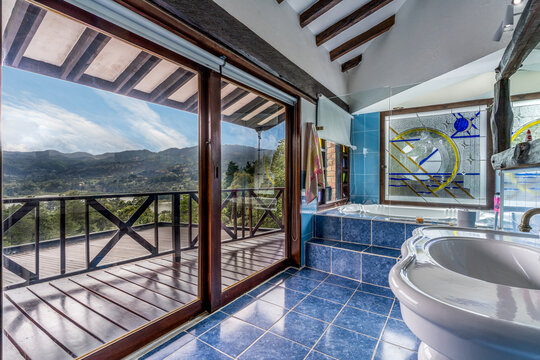 MEDELLIN, COLOMBIA - Jul 16, 2021: Beautiful unique bathroom connected to a balcony with a view interior design