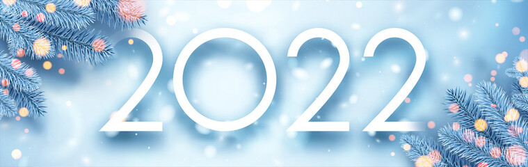 Fototapeta 2022 Christmas blue spruce branches with bokeh lights. obraz