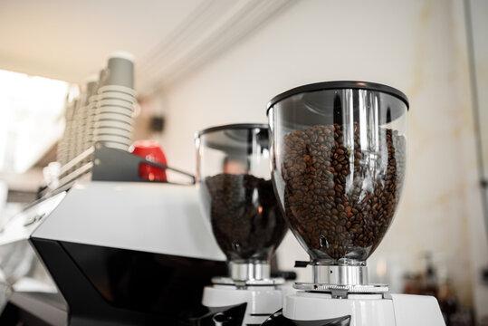 Close-up professional coffee machine making espresso in a cafe