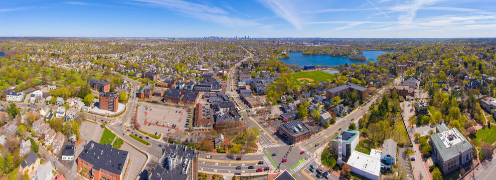 Arlington historic town center aerial view panorama on Massachusetts Avenue at Mystic Street and Broadway with Boston and Spy Pond at the background, Arlington, Massachusetts MA, USA.