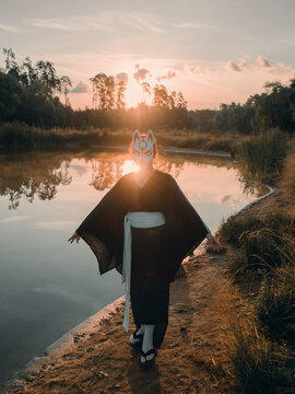 Woman wearing wolf mask standing in nature