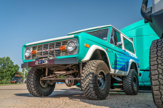 Loveland, CO, USA - August 29, 2021: Vintage, first generation,  Ford Bronco ranger wagon with an upgraded front bumper and winch promoting Falken Tires during Overland Expo Mountain West event. This