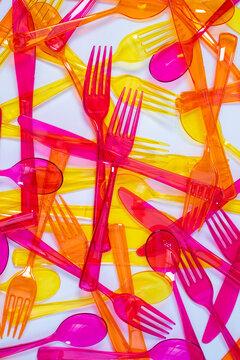 Colourful Cutlery in hap hazard arrangment