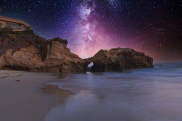 Fototapeta Stary night over Pearl Street Beach rock formation obraz