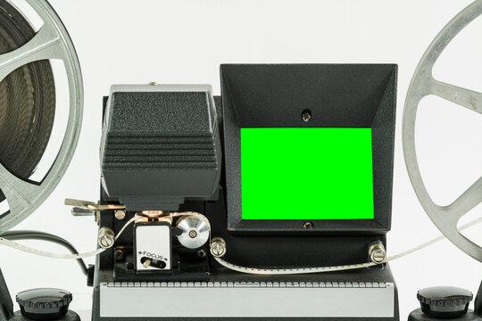 Vintage 8mm film editor machine with chroma green screen.