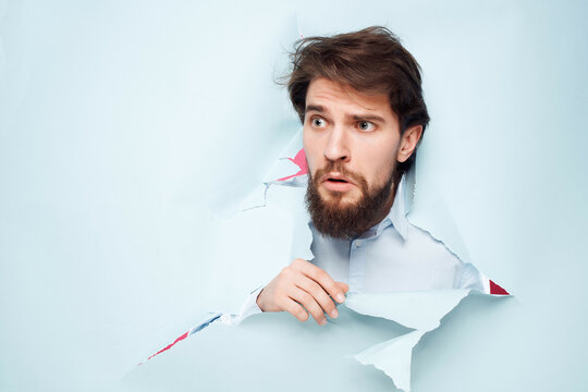 man in blue shirt peeking out of the background fun isolated background