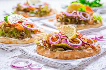 Greek gyros meat with pita flat bread, vegetables and onions and Tzatziki dip