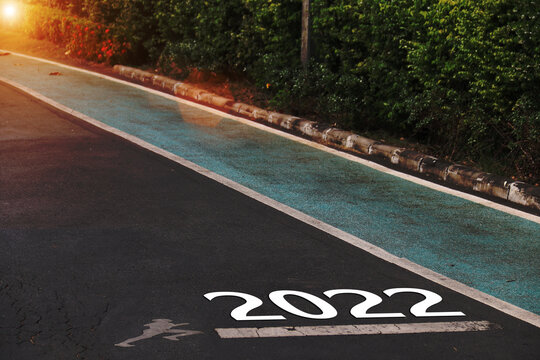 2022 is written on a highway in the middle of an empty paved road. New Year Vision 2022 Ideas