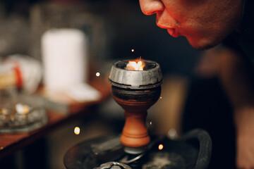 Obraz Shisha hookah hot coal man blowing and tobacco for smoking and leisure - fototapety do salonu