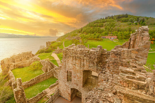 top view of Urquhart Castle at sunset beside Loch Ness in Scotland, United Kingdom. Close to Inverness city. It is one of the most visited castles for the legend of the Loch Ness monster.