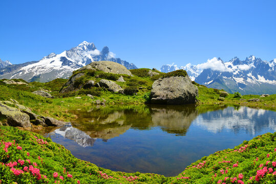 Mountain landscape reflected on the surface of the lake. Nature Reserve Aiguilles Rouges, French Alps, France, Europe.