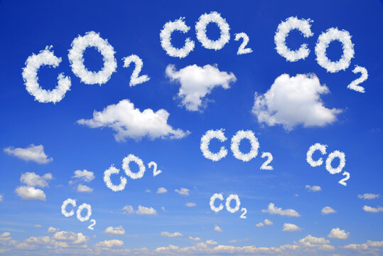 Blue sky with CO2 text from clouds. Global warming or change climate concept. Environmental problems. Growing Carbon Dioxide in the atmosphere.
