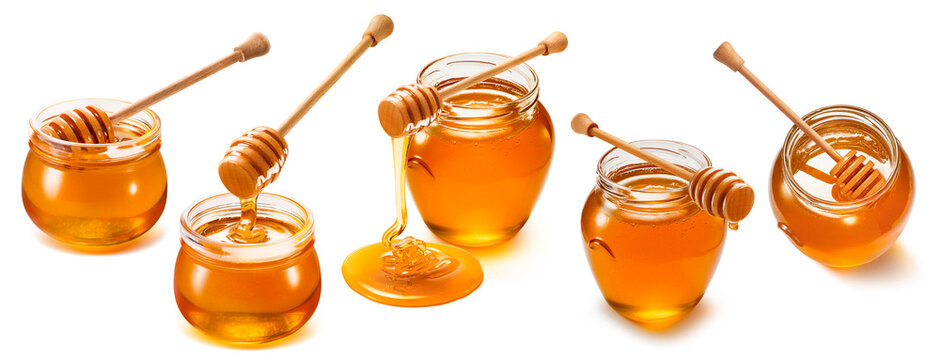 Honey jars and wooden dippers set isolated on white background