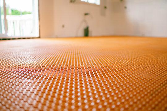orange roll membrane waterproofing on the floor