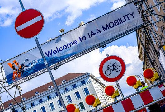 Munich, Germany - September 9: sign of the IAA (Internationale Auto Ausstellung - translation: international auto exhibition) trade fairand a no bike sign in Munich on September 9, 2021