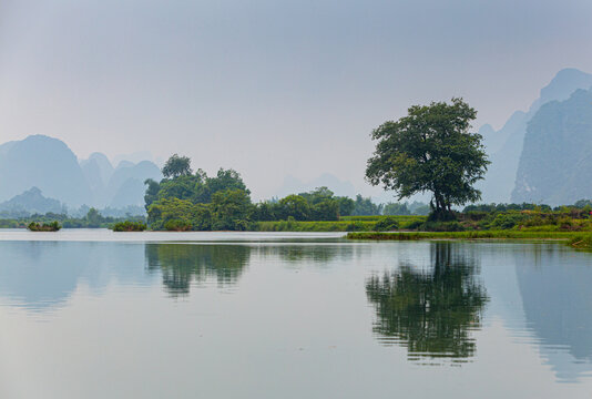 landscape with the Yulong river and limestone mountains in hazy weather, Yangshuo, Quangxi province, China