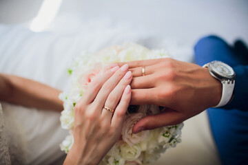 Obraz Groom and brides hands with rings, closeup view. - fototapety do salonu