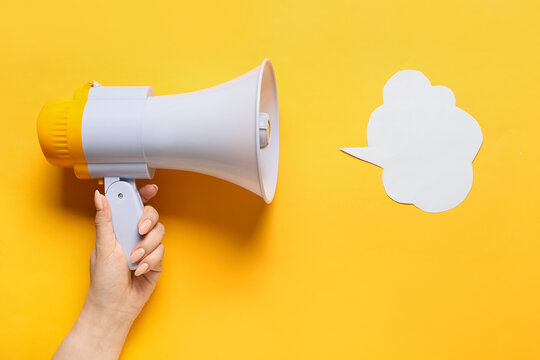 Woman with megaphone and speech bubble on color background