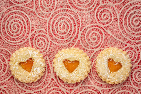jam heart biscuits on Japanese lace paper with a spiral pattern, love or romance concept