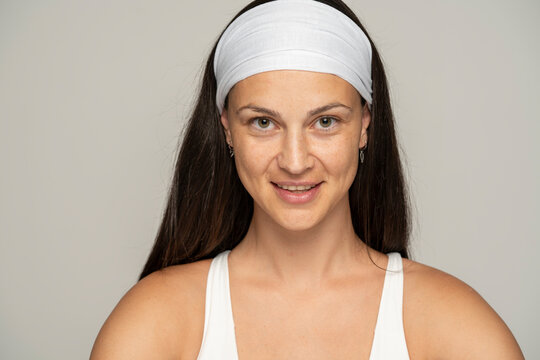 Portrait of a young happy woman without makeup and headband