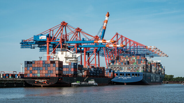 HAMBURG, GERMANY - Aug 24, 2021: View at the Burchardkai in Hamburg with many big container ships loading, Germany