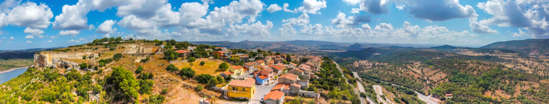 Panoramic view of Monteleone Roccadoria under a cloudy sky
