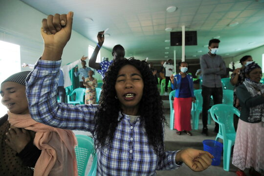 A woman prays after religious institutions declared a five days prayer session to end the war in Tigray, in a church in Addis Ababa