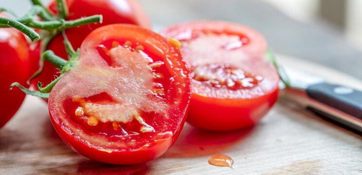 Cut Truss Tomatoes on Board with Knife