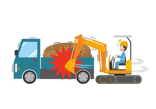 ショベルカーをトラックにぶつけてしまう作業員