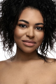 Young beautiful black woman with smooth skin on white background