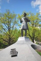 Obraz Taras Shevchenko statue in a city park. Warsaw, Poland. Ukrainian poet, writer, artist, public and political figure. Landmark. sightseeing, culture, history, past, literature, art - fototapety do salonu