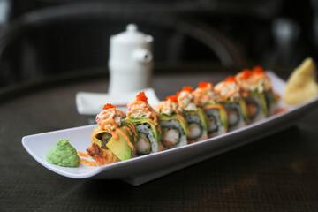 Fototapeta Delicious shrimp avocado sushi roll on a plate obraz