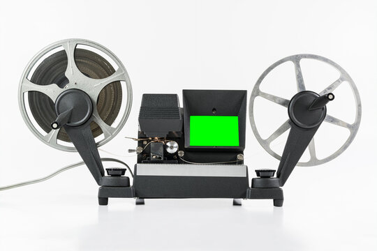 Vintage 8mm film editing machine with chroma green screen.