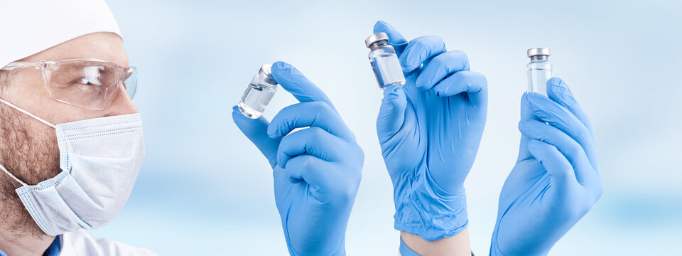 Doctor holding a viol with vaccine against corona virus.
