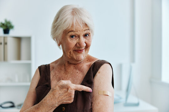 emotional old woman hand injection vaccine passport covid-19