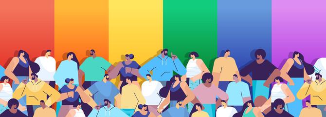 Fototapeta mix race people group standing together near lgbt rainbow flag gay lesbian love parade pride festival transgender love obraz